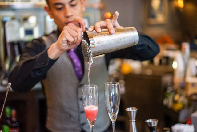 A bartender serves up a cocktail at the world-famous Carousel Bar inside Hotel Monteleone in the French Quarter of New Orleans.