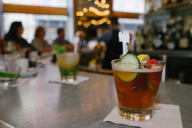 Enjoy a Pimm's Cup cocktail at the world-famous Carousel Bar inside Hotel Monteleone in the French Quarter of New Orleans.