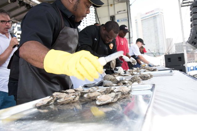 Oyster shuckers show off their skills during Oyster Fest. (Photo courtesy New Orleans Oyster Festival on Facebook)