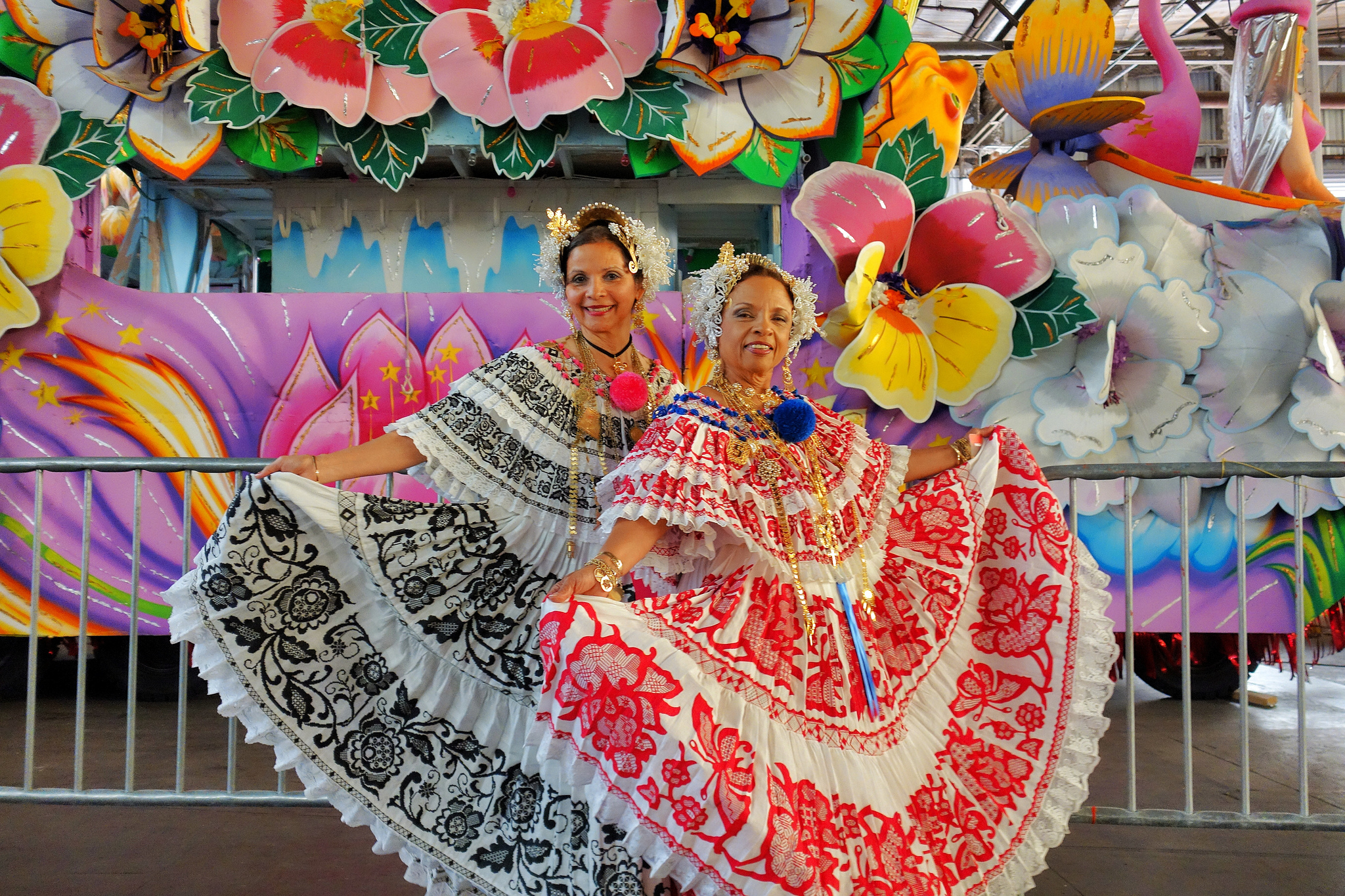 Women in traditional garb at Carnaval Latino