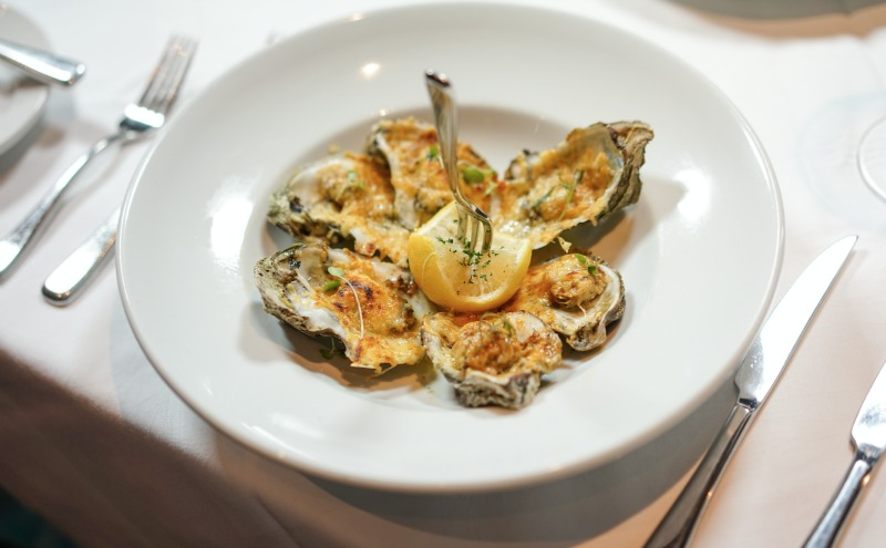 After the fest, enjoy the char-grilled oyster appetizer at Criollo Restaurant. (Photo: Paul Broussard)