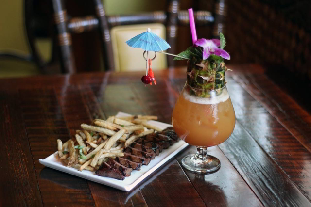 Locals love Latitude 29 for happy hour and late night tiki drinks and tropical bites.