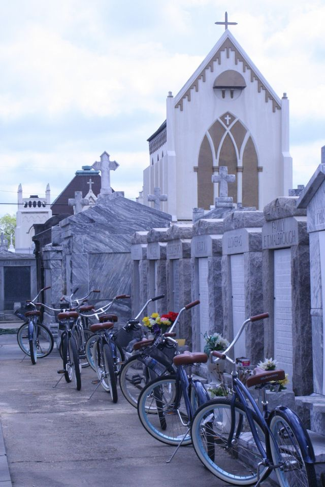 Confederacy of Cruisers offers bicycle tours of New Orleans, including a 9th Ward tour with a stop at the St. Roch Cemetery. (Photo courtesy via Flickr user jodi0327.)