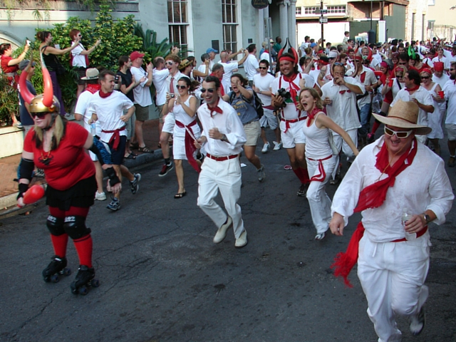 To maintain the traditional Spanish feel, runners at San Fermin in Nueva Orleans are required to wear white and red to participate. (Photo courtesy Flickr user Mark Gstohl.)