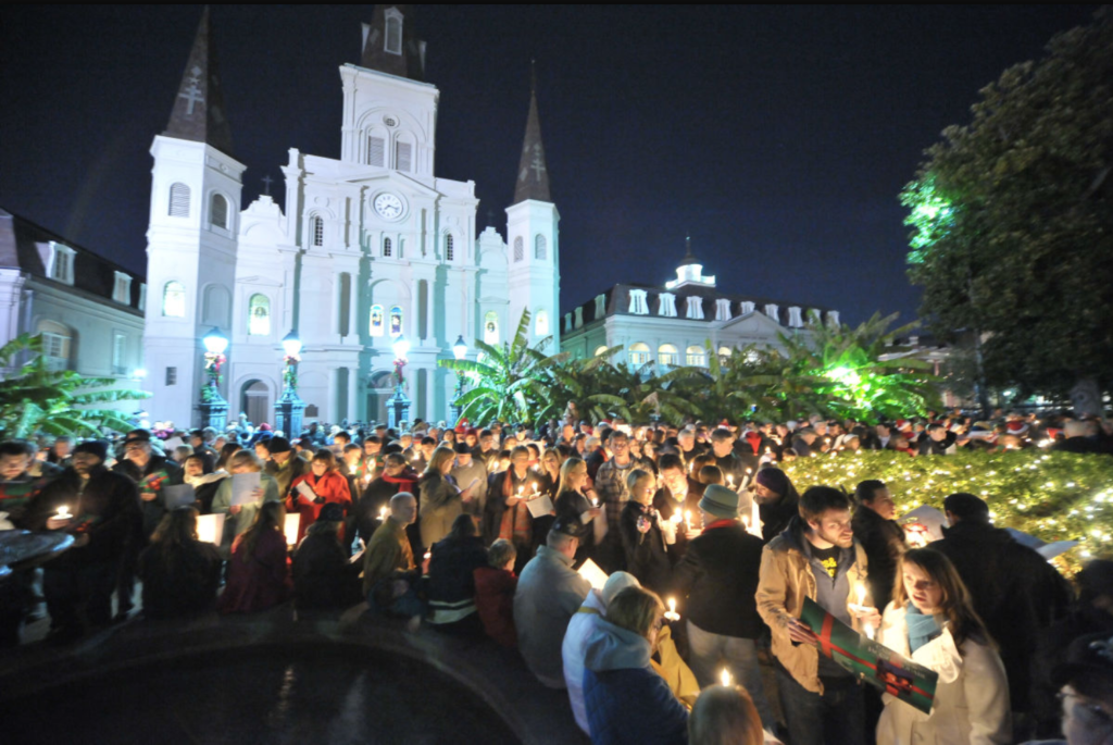 Caroling in jackson square, one of the top reasons to book your French Quarter stay at Hotel Monteleone this holiday season